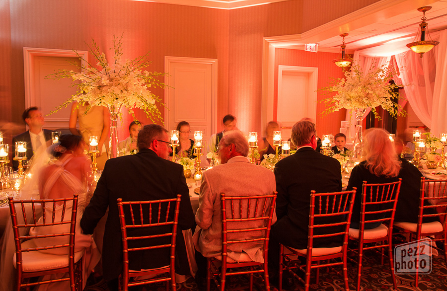 la-vie-en-rose-wedding-reception-lights-drapes-table-setting-centerpieces-candles-mercury-gold-chargers-overlays-napkins-linens-runner-orchids-chiavari-chairs-roses-queen-anne's-lace-the-tampa-club