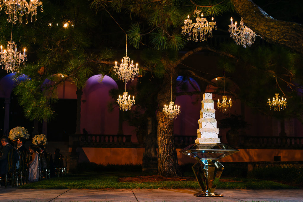 La-vie-en-rose-sarasota-florida-wedding-white-reception-flower-cake-elegant-chandelier-lighting-ringling-museum