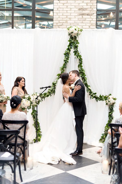 La-vie-en-rose-tampa-florida-wedding-white-garden-flower-eucalyptus-ceremony-garland-elegant-oxford-exchange