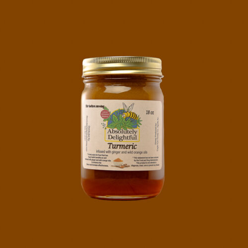 One 18oz Jar of Turmeric Ginger and Wild Orange Oil Infused Honey