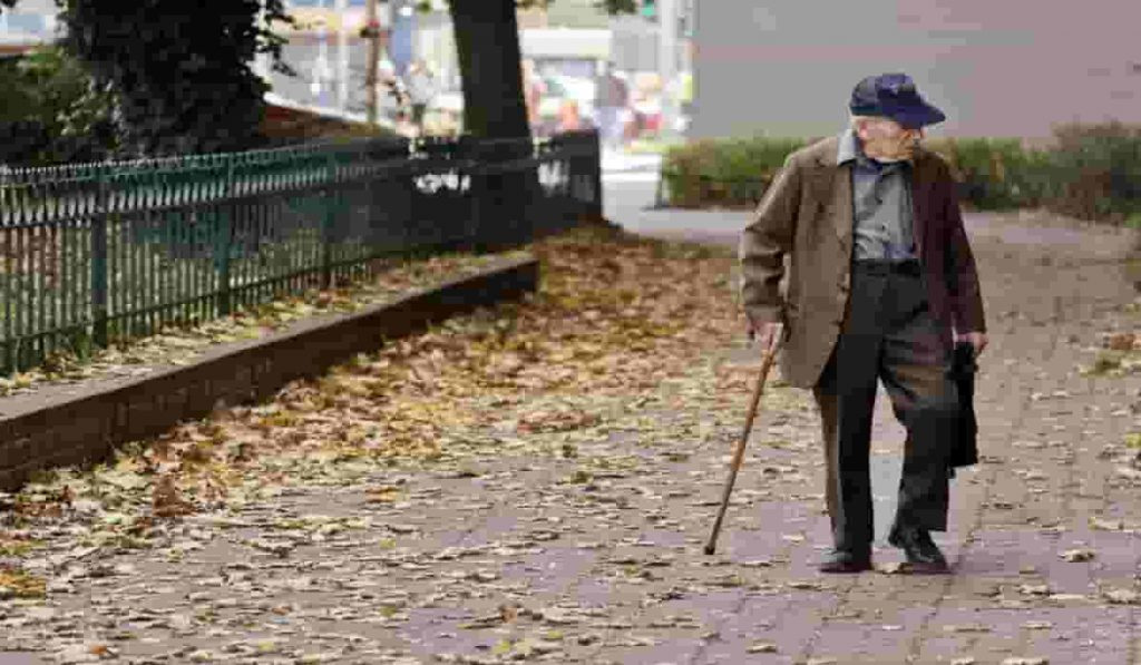 old man walking with a stick