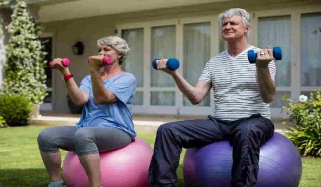 old man and woman exercising