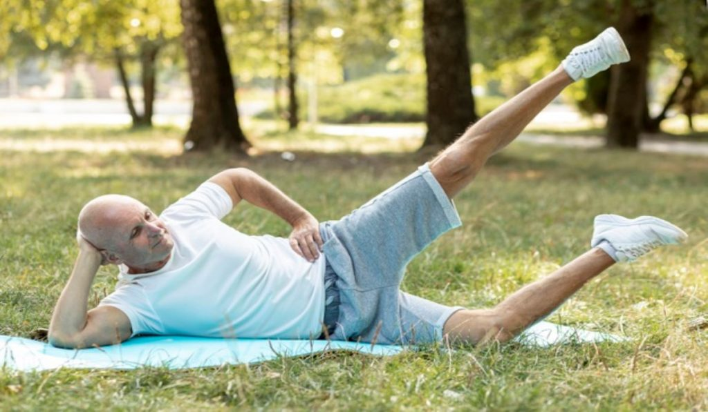 An old man stretching in the park: yoga poses for senior citizens