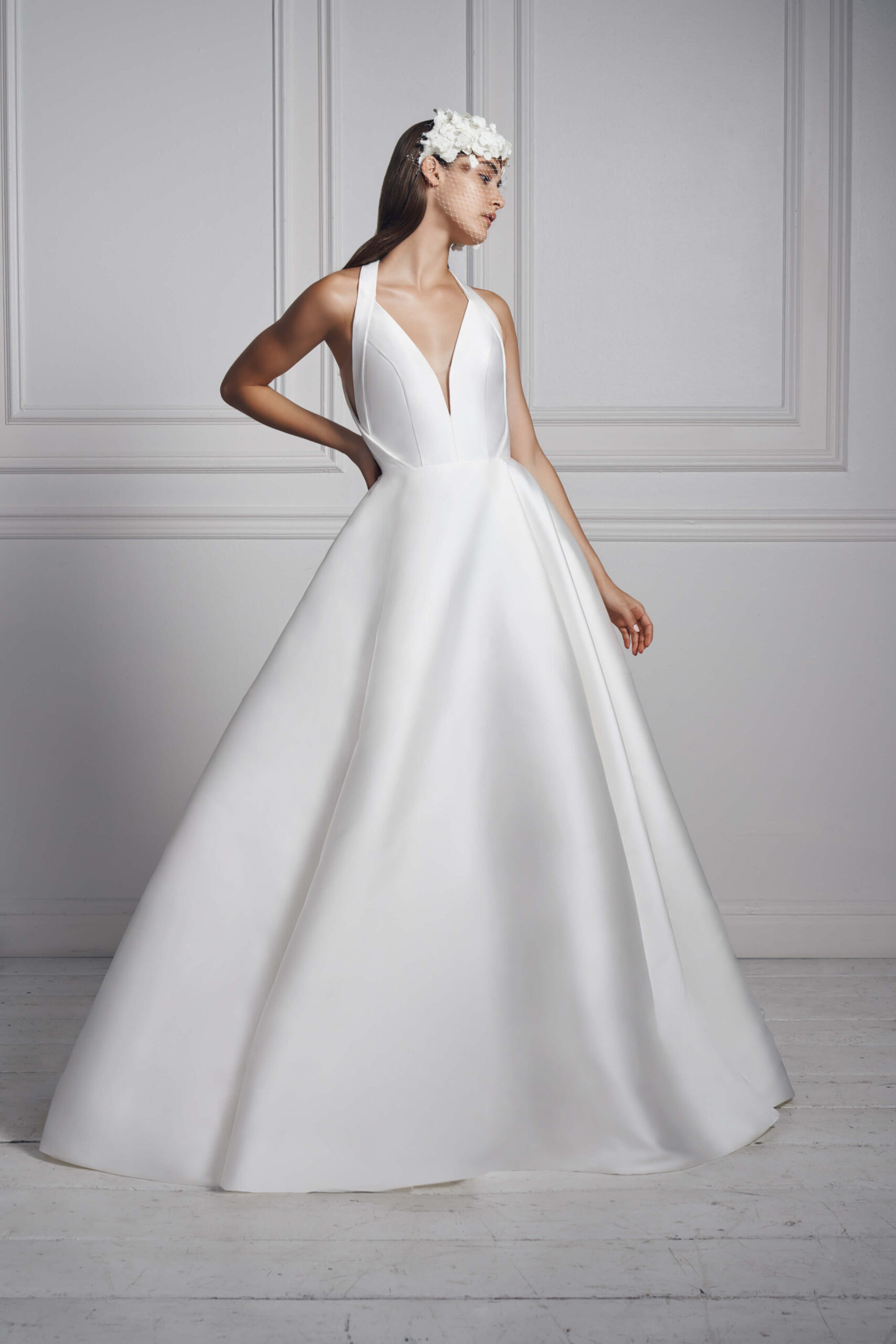 Plunging halter ball gown by Anne Barge.