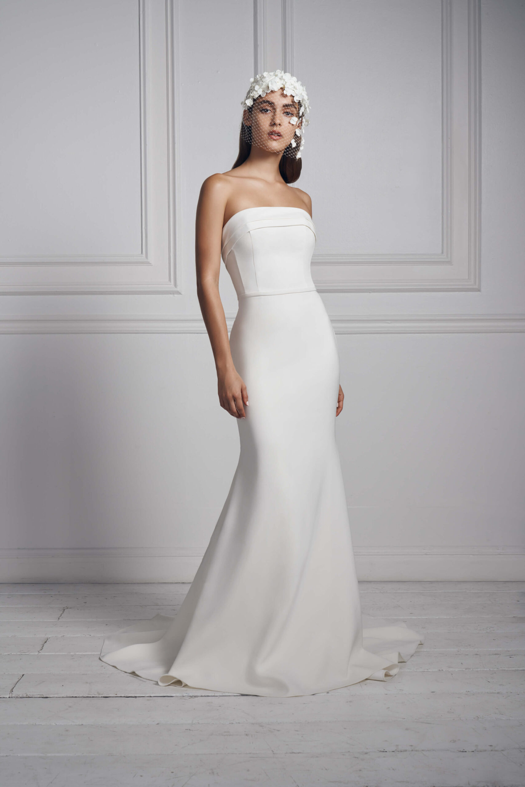 Anne Barge's columnar strapless bridal gown comes with arched pleated cuffs