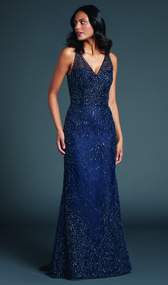 Introducing All-star. A plunging V-neck column gown of beaded embroidered tulle.