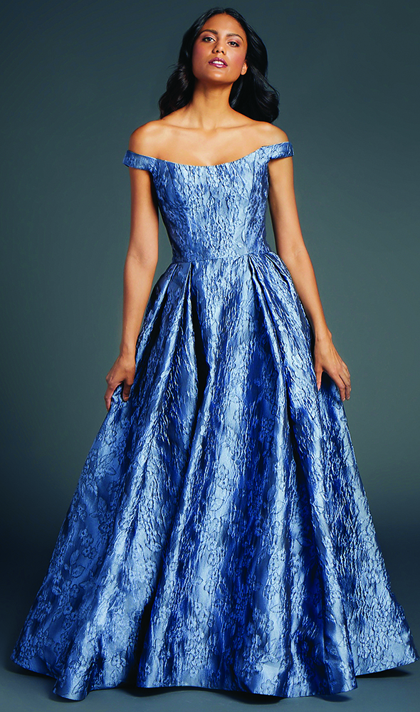 Helena by Anne Barge.Off the shoulder ball gown with architectural seams at bodice of crinkled floral jacquard.
