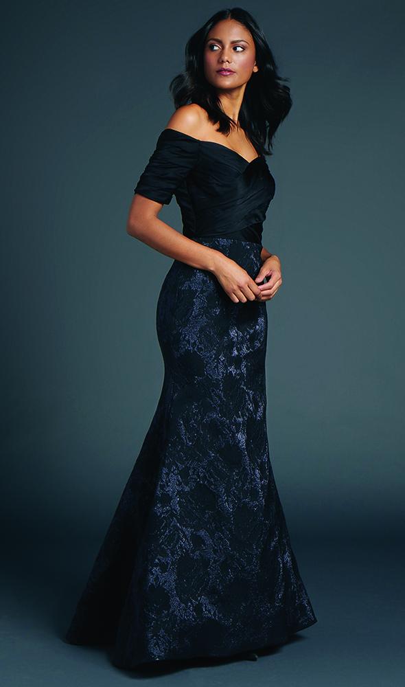 Enjoy the sweetheart portrait neckline draped bodice with elbow length sleeves & mermaid skirt of metallic jacquard.