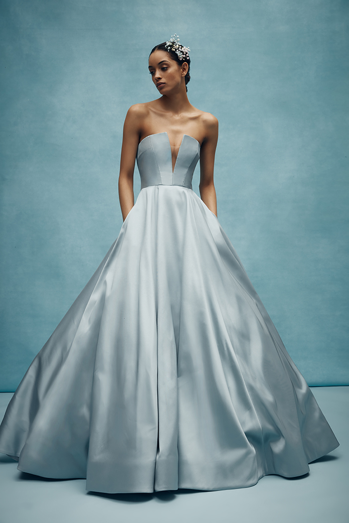Fall in love with Anne Barge's architecturally seamed V-notched bodice with full ballgown skirt of mikado scuba. Emory comes in a steel blue tone. Emory by Anne Barge