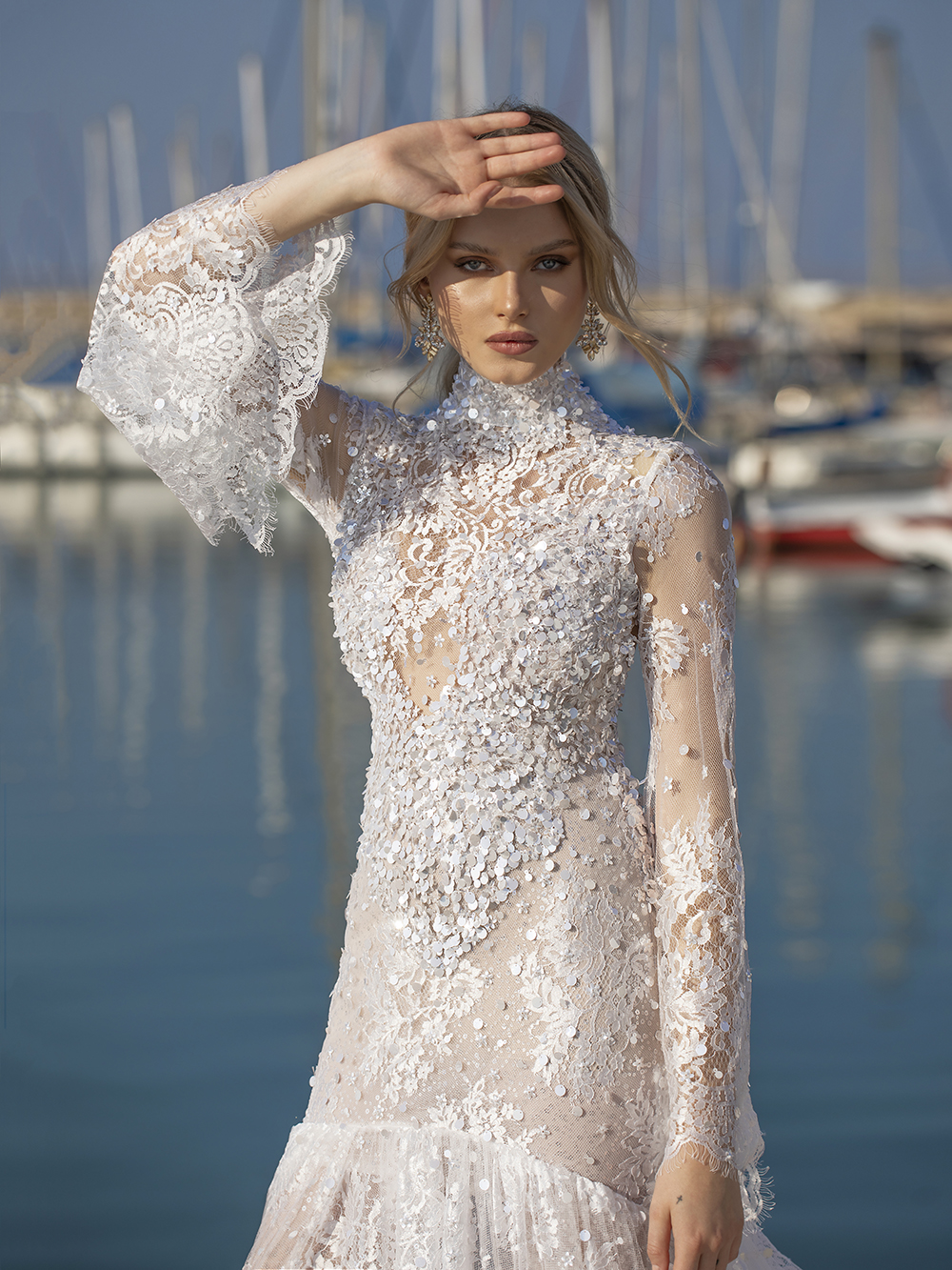 From The Love Story Collection. High neckline and signature long sleeves with a lace flare. Helena hugs the body and opens into an exceptional train.