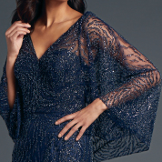 Ally Capelet By Anne barge. Beaded tulle cape with draped cowl at back.