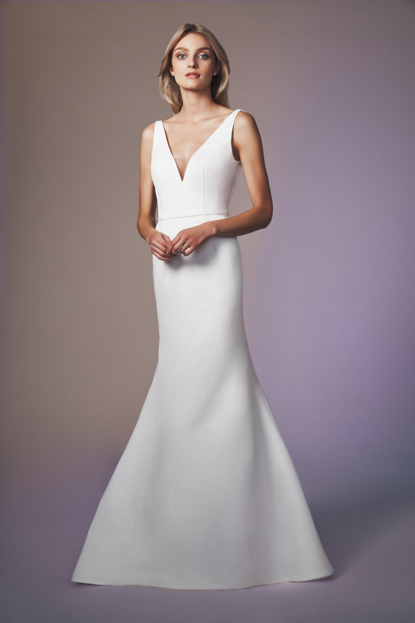 V-neck fit and slightly flared gown of faille accented with low V pleated back bodice The Moet gown is made to order. Please allow 16 weeks for delivery. Rush options may be available. Please contact an Expert stylist to confirm.