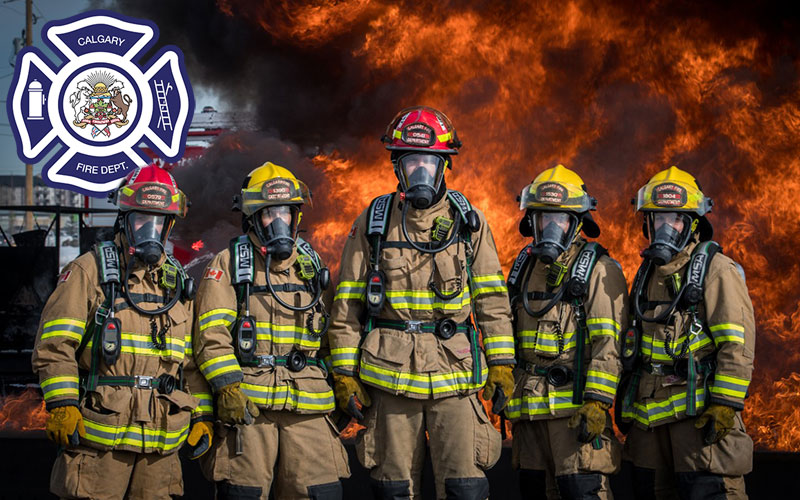 Calgary Firefighters standing in front of fire