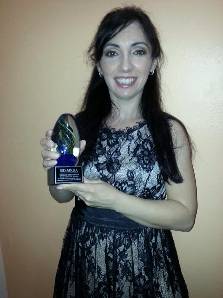Milene with Award from SMKBA