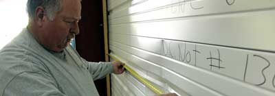 man measuring impact after fenestration testing