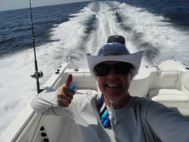 Josee on big boat with thumbs up