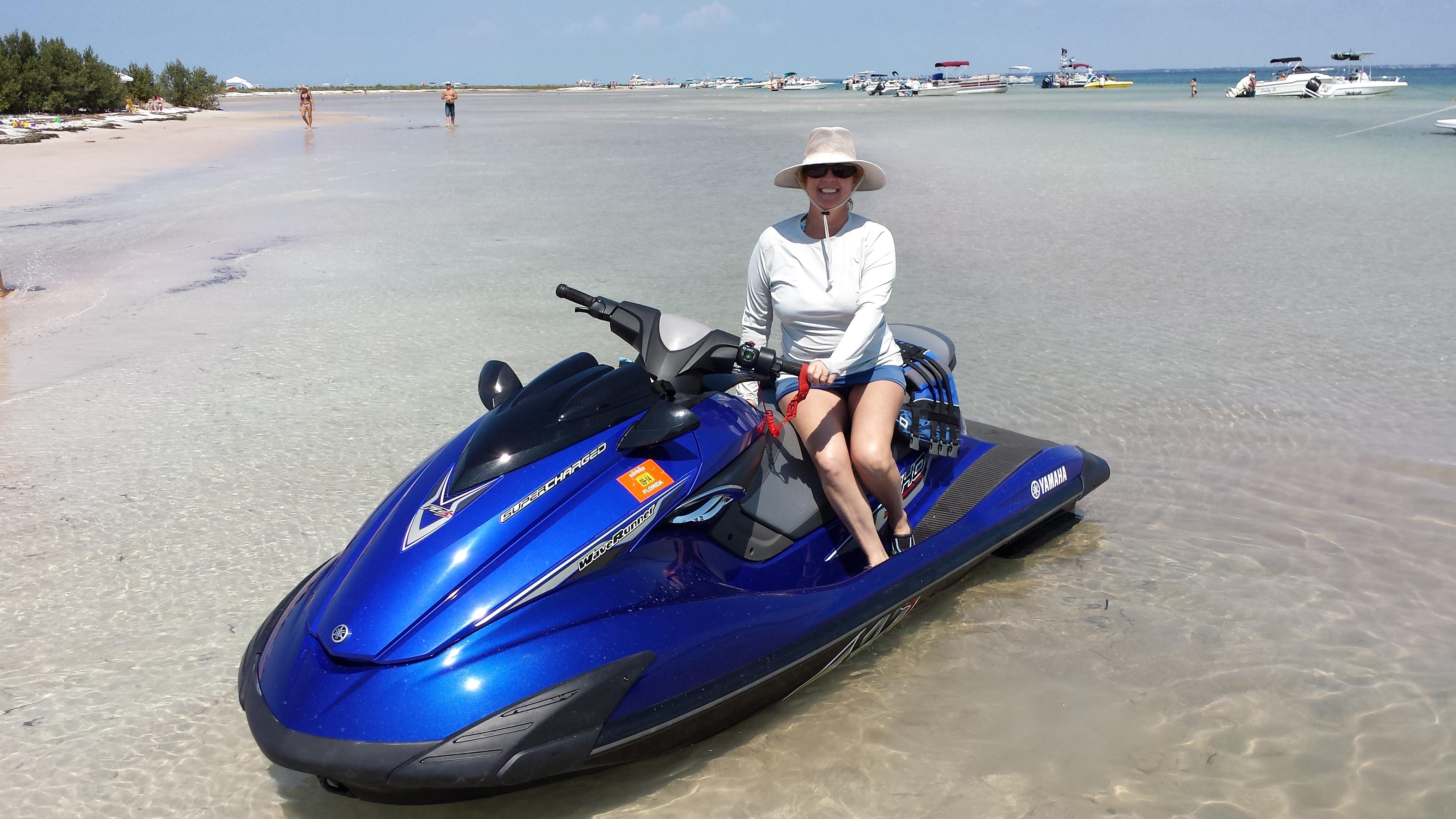 Josee sitting on blue waverunner