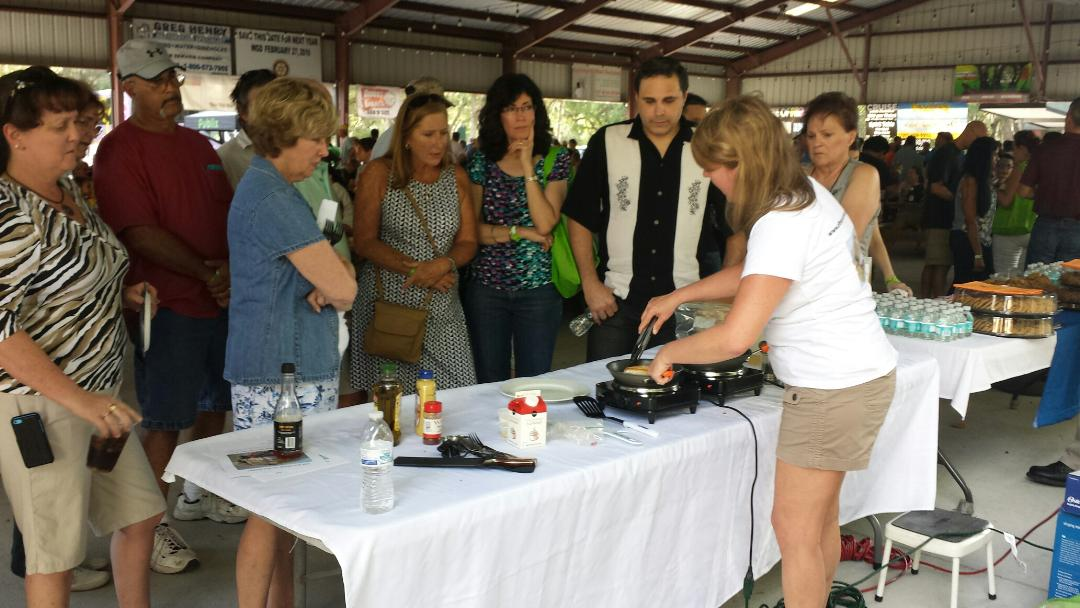 me doing my cooking demo fans paying close attention