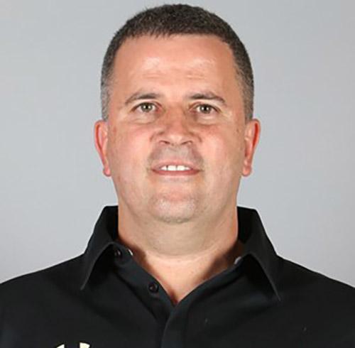 Male coach Dega Dagama smiling