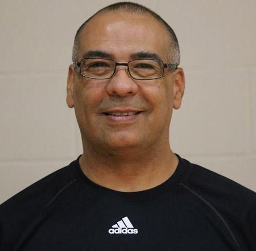 Male coach Fabian Ardila smiling