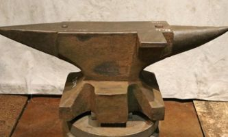 528 lb $2,500 North German double horn anvil with side shelf