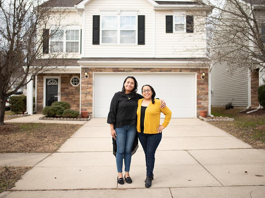 two women standing in driveway