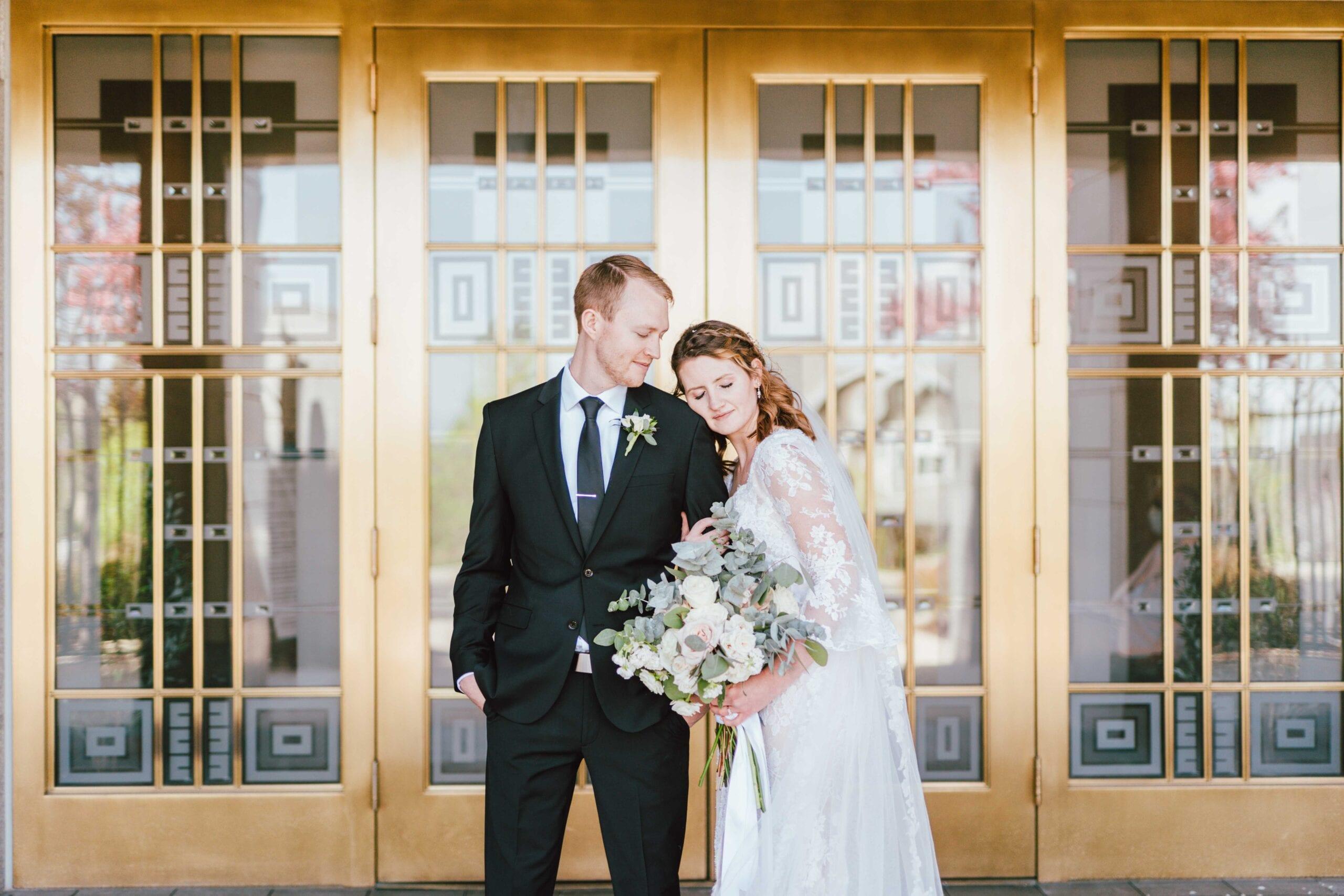 draper utah temple wedding bride and groom at doors