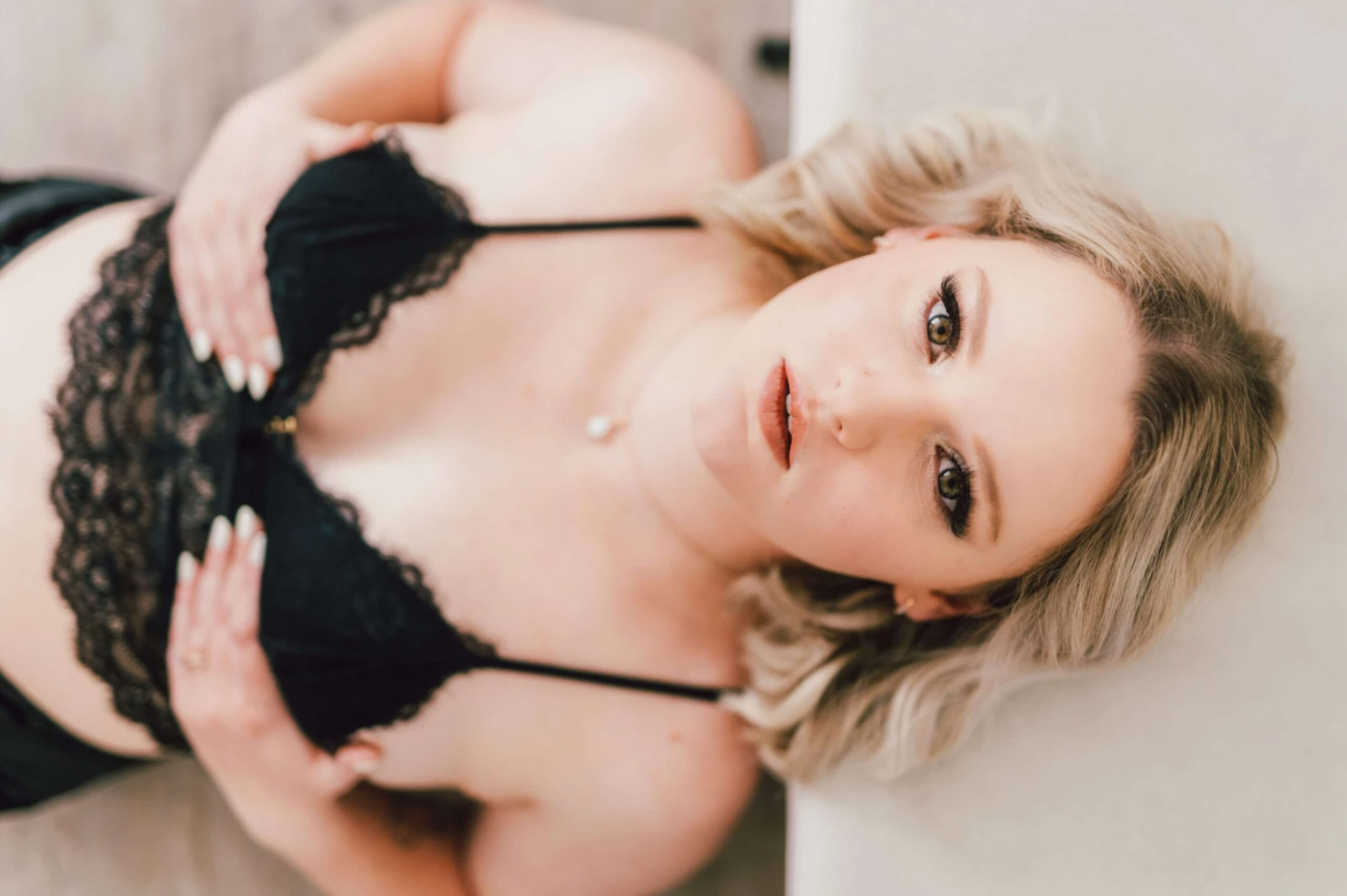 love brittny boudoir holding breasts