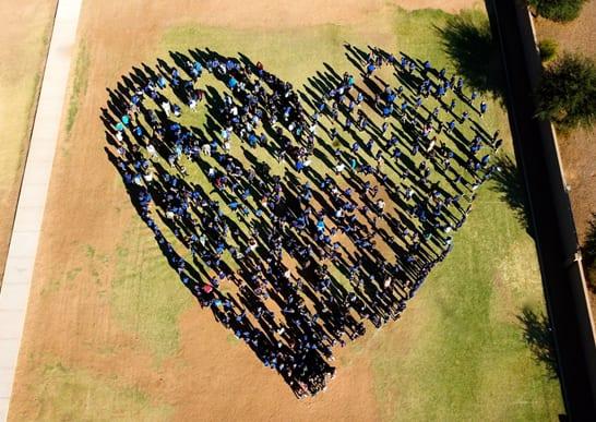 Kids in a Field Standing in a Heart Shape