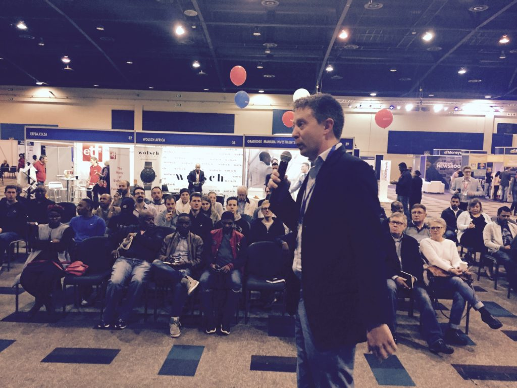 View from the top. Marc Ashton, MD of Moneyweb, introduces Team Just One Lap at the Money Expo.
