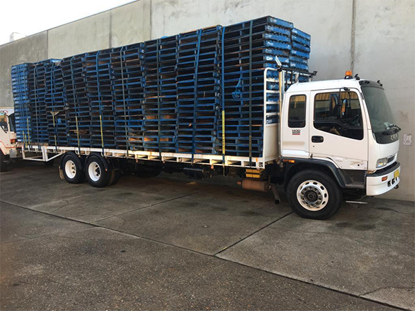 Freight forwarder truck carrying pallet racking