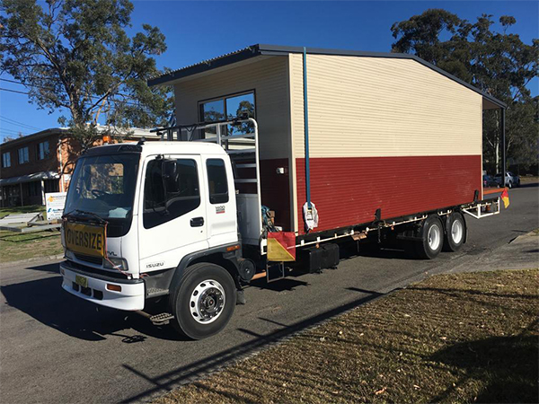 Freight forwarder truck carrying site shed