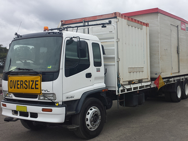 Freight forwarder truck doing shipping container transportation