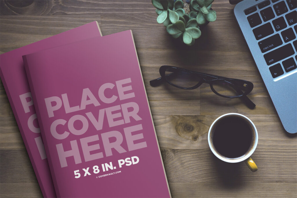 Paperback Coffee Table Book Mockup with Laptop