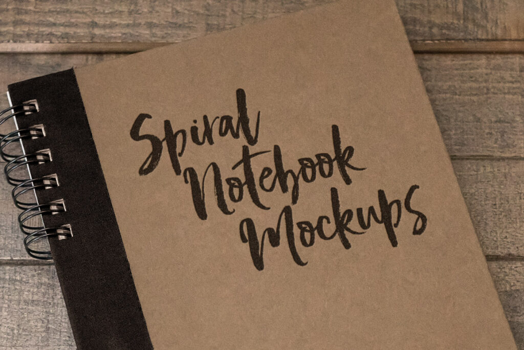 Spiral Notebook with a Wood Background Mockup
