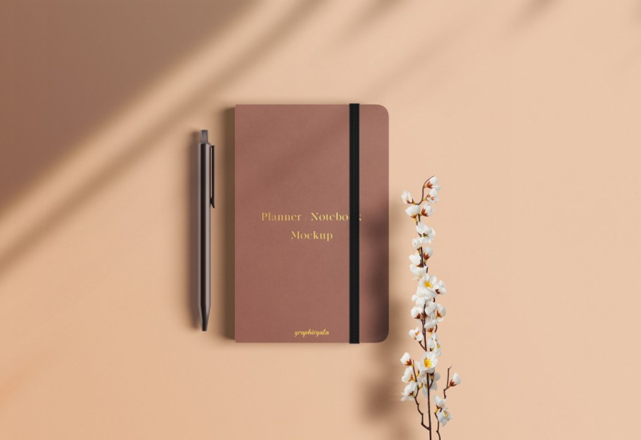 Notebook with Pen and Flower Mockup