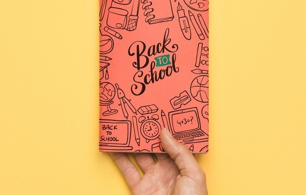 Notebook in Hand Mockup