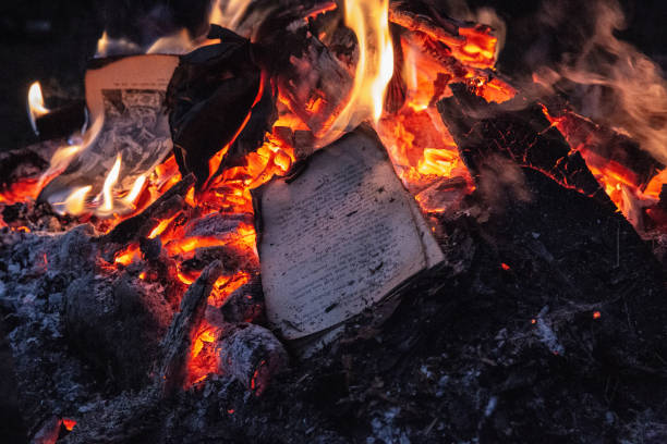 Scattered Book Pages on Fire