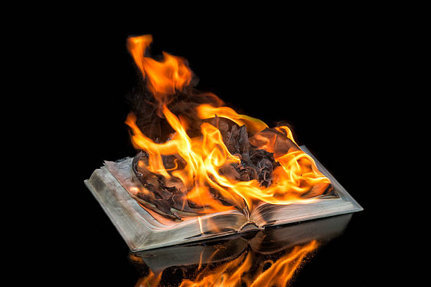 Book on Fire on Black Background
