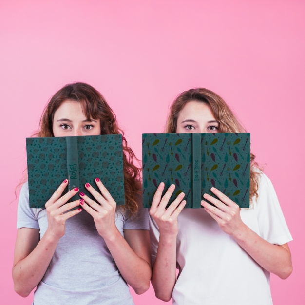 Young Girls Holding Book