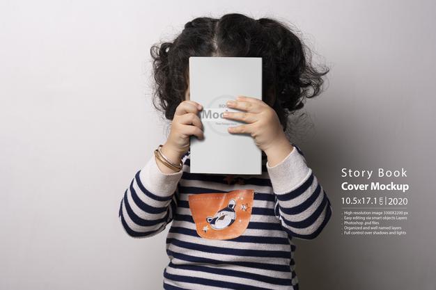 Little Girl Holding Story Book