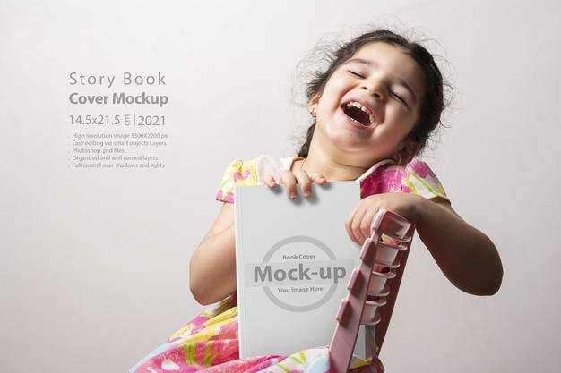 Happy Little Girl Holding Story Book