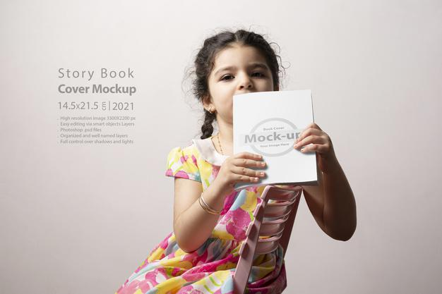 Little Girl Sitting and Holding Story Book