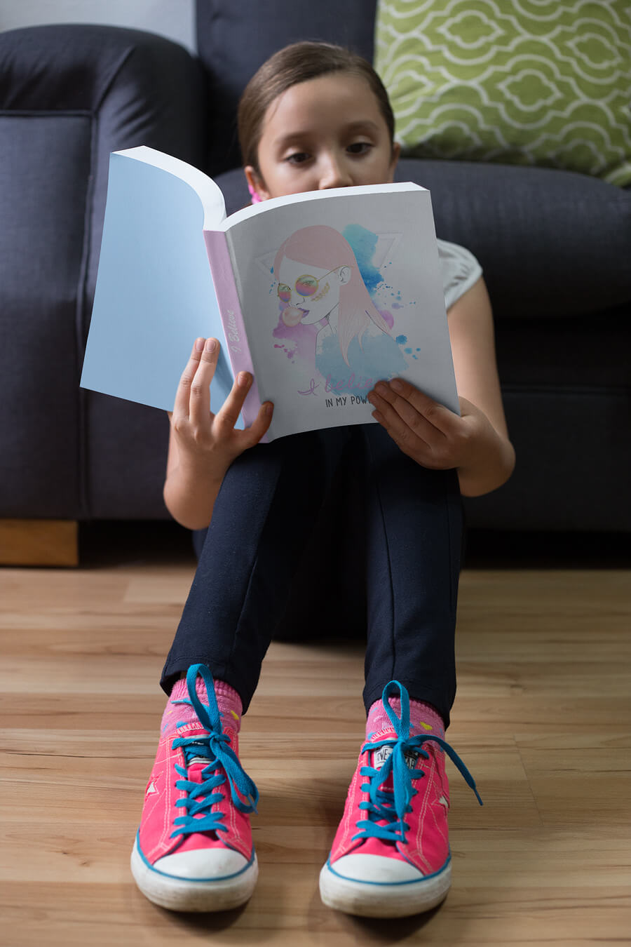 Girl Reading a Book While Sitting