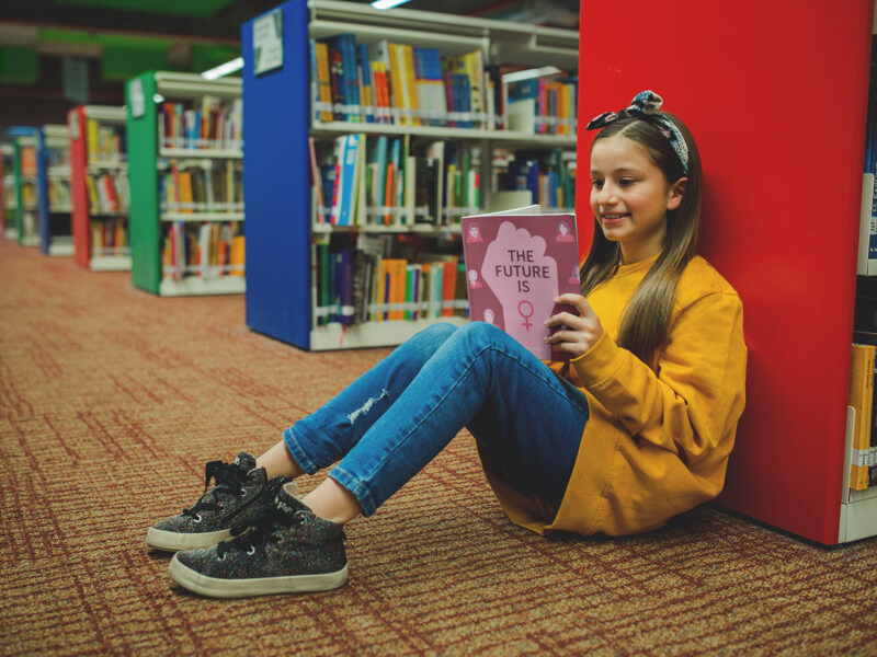 Girl with a Yellow Sweater Reading a Book