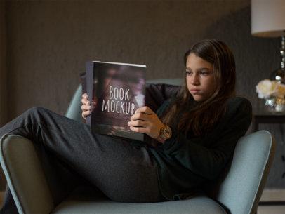 Girl Reading a Book on an Armchair