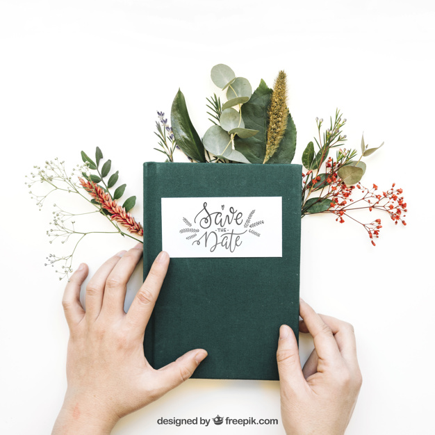 Hands Holding Book with Plants