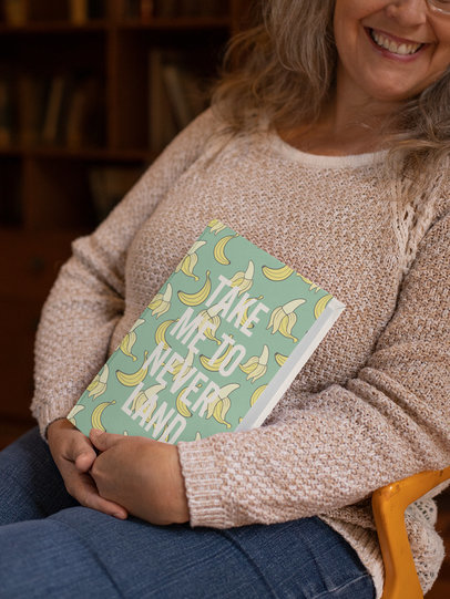 Happy Woman Holding a Book to Chest