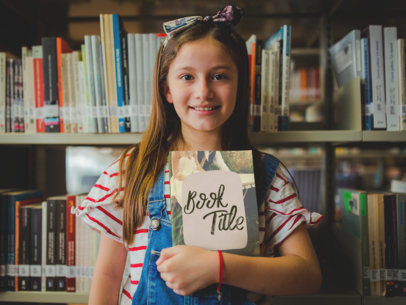 Little Girl at a Library Holding a Book to Chest