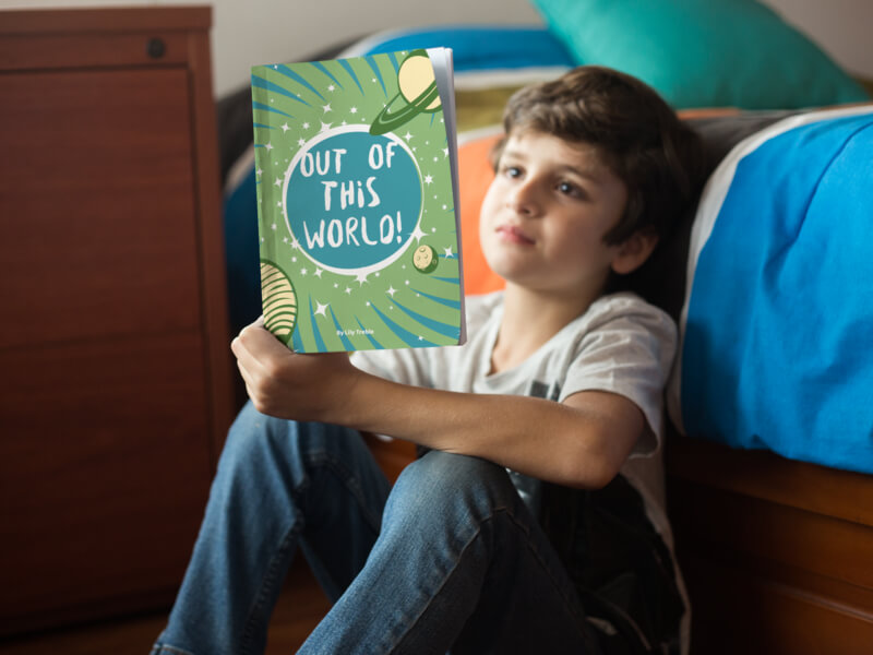 Kid Reading a Book By His Bed